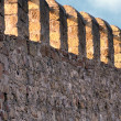 Fortified wall of an ancient castle - Stock Photo
