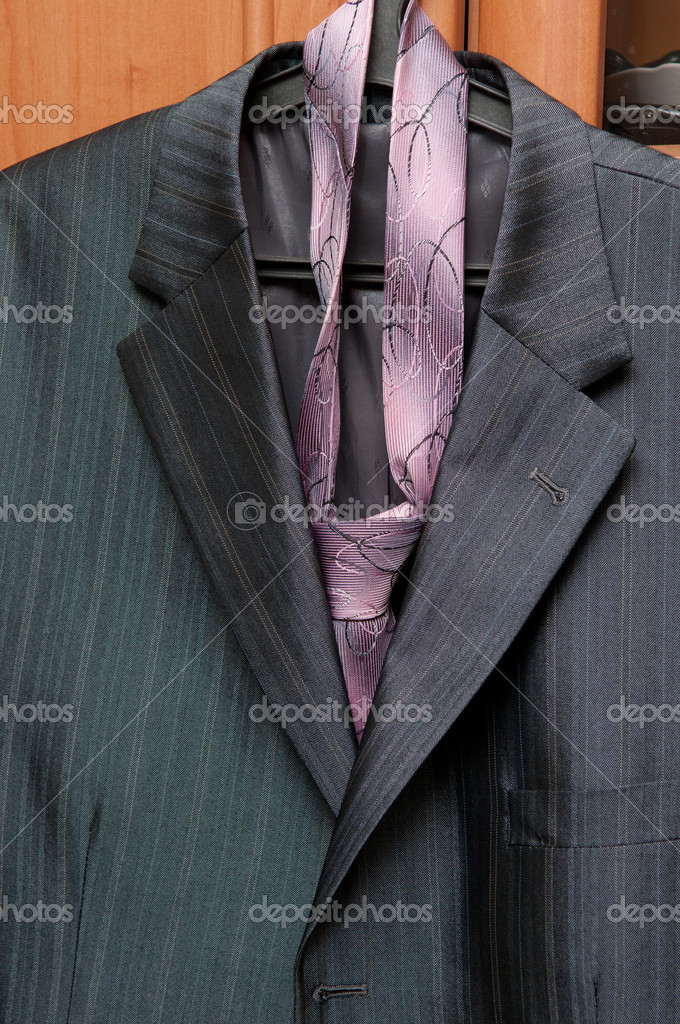 Jacket and tie, hang on a hanger — Stock Photo #7722288