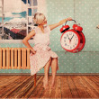 Beautiful woman in room with clock — Stock Photo