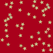 Gold stars on red background — Stock Photo