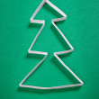 Paper christmas tree on green background — Stock Photo