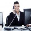 Smiling woman busy over phone — Stock Photo