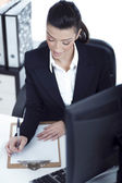 Portrait of young business woman working at her office — Foto Stock