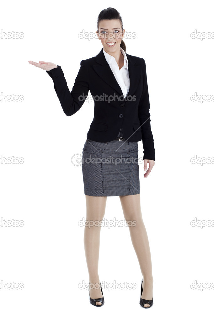 Full length of young woman pointing copysapce over white background  Stock Photo #6758179