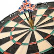 Royalty-Free Stock Photo: Three Darts Arrows Poked Right In The Center