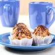 Cakes plate and cups on table — Stock Photo #7100830