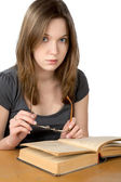 Girl with glasses and the open book isolated — Stock Photo
