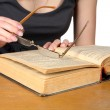 Hands of girl with glasses over the opened book isolated — Stock Photo