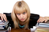 The girl with two piles of writing-books isolated — Stock Photo