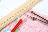 Pencil compasses and ruler on a topographic map — Stock Photo