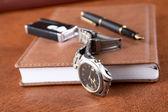 Watch lighter pen and an organizer — Stock Photo