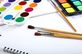 Water colour paints brush albums for drawing on a table — Stock Photo