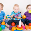 Babies Play With Toys - Stock Photo