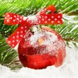 Snowy red Christmas ball — Stock Photo