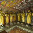 Ancient Buddha images in Dambulla Rock Temple caves, Sri Lanka - Stock Photo