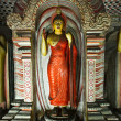Ancient Buddha image in Dambulla Rock Temple caves, Sri Lanka - Stock Photo