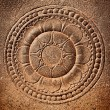 Stylized lotus carved on stone — Stock Photo #7341368