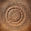 Stylized lotus carved on stone - Stock Photo