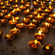 Burning candles in Buddhist temple. McLeod Ganj, Himachal Prades - Stock Photo