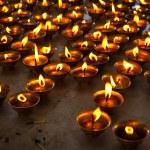 Burning candles in Buddhist temple. McLeod Ganj, Himachal Prades — Stock Photo #7341507