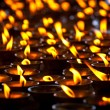 Stock Photo: Burning candles in Buddhist temple. McLeod Ganj, Himachal Prades