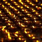 Burning candles in Buddhist temple. McLeod Ganj, Himachal Prades — Stock Photo #7341509