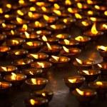 Burning candles in Buddhist temple. McLeod Ganj, Himachal Prades — Stock Photo