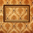 Vintage gold plated picture frame  on retro wallpaper — Stock fotografie