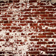 Stock Photo: Old brick wall with remains of plaster