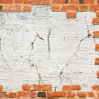 Brick wall with a hole — Stock Photo
