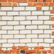 Brick wall surrounded with another wall - Stock Photo