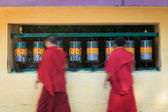 Buddhist monks rotating prayer wheels in McLeod Ganj — Stock Photo