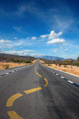Twisting lane marking on road in desert — Stock Photo