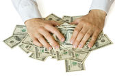 Greedy hands grabbing money — Stock Photo