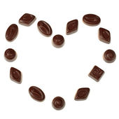 Heart made of isolated chocolate candies — Stock Photo