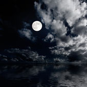 Moon and clouds above sea at night — Stock Photo