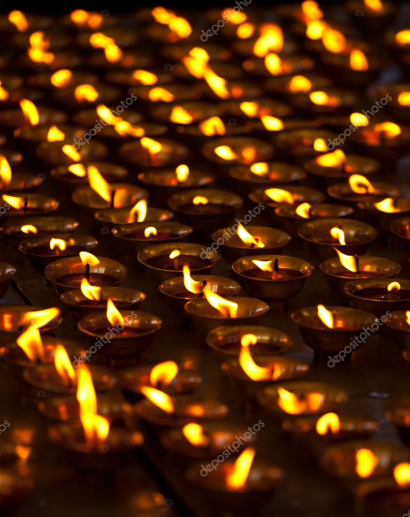 Burning candles in Buddhist temple. Tsuglagkhang complex,  McLeod Ganj, Himachal Pradesh, India  Stock Photo #7341509