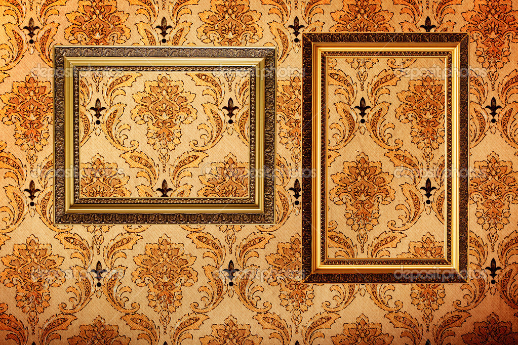 Vintage gold plated picture frames  on retro wallpaper background — Stock Photo #7341585