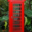Red English telephone booth - Stock Photo