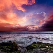Foto Stock: Rocky coast. Sunset