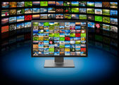 TV with images on multimedia background — Stock Photo