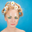 Portrait girl blonde with flowers in her hair — Stock Photo #6983079