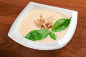Vegetable cream soup with smoked meat — Stock Photo