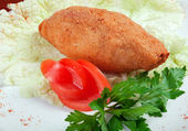 Chicken cutlets with parsley on white plate — Stock Photo