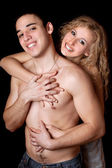 Portrait of happy young couple. Isolated on black — Stock Photo