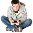 Furious young man with a joystick for game console — Stockfoto