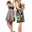Two smiling young women with dogs — Stock Photo
