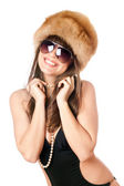 Smiling woman in black swimsuit and fur-cap — Stock Photo