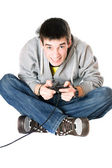 Young man with a joystick for game console — Stock Photo
