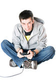 Furious guy with a joystick for game console — Stock Photo